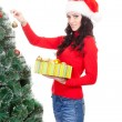 Stock Photo: Womdecorating artifical fur tree