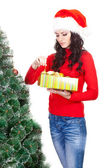 Woman taking toy for artifical fur tree — Stock Photo