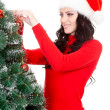 Happy woman decorating artifical fur tree - Foto Stock