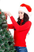 Happy woman decorating artifical fur tree — Stock Photo