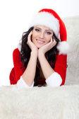 Woman in santa costume laying on sofa — Stock Photo