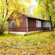House in wood (autumn) — Stock Photo