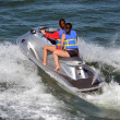 Young Ladies Riding on a Silver Jet-ski — Stock Photo