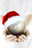 Merry Christmas and globe — Stock Photo