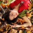 Lady in autumn park — Stock Photo