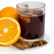 Christmas hot wine with oranges over white background - Stock Photo