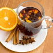 Christmas hot wine with oranges on wooden table - Stock Photo
