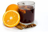 Christmas hot wine with oranges over white background — Stock Photo