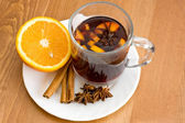 Christmas hot wine with oranges on wooden table — Stock Photo