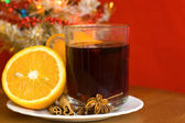 Christmas hot wine with oranges over Christmas background — Stock Photo