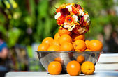 Bouquet and oranges — Stock Photo