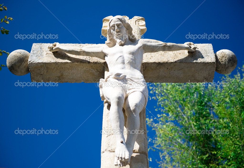 Jesus Christ on a crucifix — Foto de Stock   #6985780