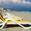Постер, плакат: Deck chairs on the beach