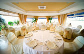 Wedding interior with table and chairs — Stock Photo