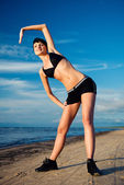Young attractive woman doing fitness exercise — Stock Photo