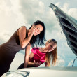 Stock Photo: Two young women with broken car on road