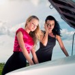Royalty-Free Stock Photo: Two young women with broken car on a road