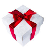 White gift box decorated with red ribbon — Stock Photo
