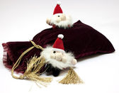 Santa Claus toy and fancy luxury gift bag — Stock Photo