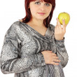 Woman holds apple — Stock Photo