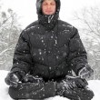 Man meditating in winter — Stock Photo