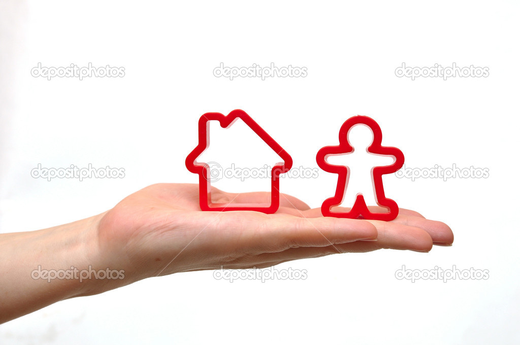 Hand and toy house isolated on white background   Stock Photo #6865866