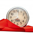 Alarm-clock with red ribbon on white — Stok fotoğraf