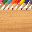 Color pencils on wood background — Stock Photo