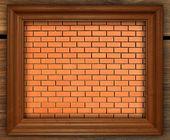 Blank photo frame on old brick wall — Stock Photo