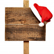 Road sign with Santa's hat — Stock Photo