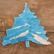 Christmas tree made of blue torn paper — Stock Photo