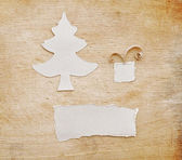 Christmas tree made of torn paper on old wood background — Stock Photo