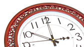 Antique looking clock face on white — Stock Photo