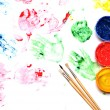 Paint brushes with opened paint buckets — Stockfoto