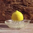Yellow lemon on a citrus squeezer — Stock Photo