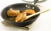 Chicken an a non stick pan — Stock Photo