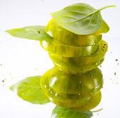 Green tomato and Basil — Stock Photo