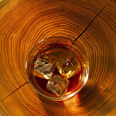 Whiskey on the rocks and wood — Stock Photo