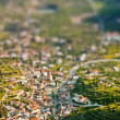 Aerial view of mountain village with tilt shift lens effect — Stock Photo