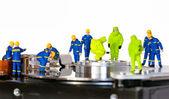 Team of technicians repair hard disk — Stock Photo