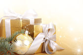 Gold gifts — Stock Photo