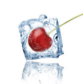 Cherry frozen in ice cube — Stock Photo