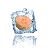 Melon frozen in ice cube — Stock Photo
