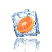 Orange frozen in ice cube — Stock Photo