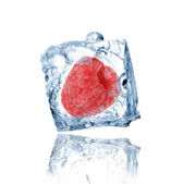 Raspberry frozen in ice cube — Stock Photo