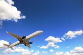 Airplane above sky — Stock Photo