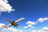 Airplane above sky — Stock Photo