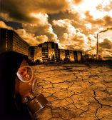 Girl in gas mask with dead earth background — Stock Photo