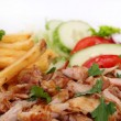 Gyros with french fries and vegetables — Stock Photo