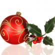 Christmas red ball with holly branch — Stock Photo
